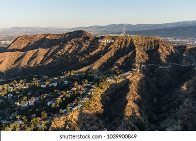 Los Angeles, California, USA - February 20, 2018:  Morning aerial view of the famous Hollywood Sign in the Santa Monica Mountains with the San Fernando Valley in background.