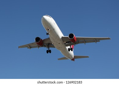 LOS ANGELES, CALIFORNIA, USA - JANUARY 28: Virgin America Airbus A320-200 lands at Los Angeles Airport on January 28, 2013. The plane has a range of range 3,300 miles with 150 passengers.