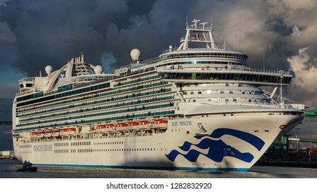 Los Angeles, California USA - January 12, 2019: Ruby Princess cruise ship begins a voyage in Port of Los Angeles main channel against a dramatic sky. 951 feet long, carries 3,080 passengers.