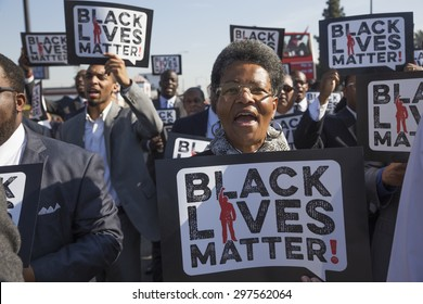 "Los Angeles, California, USA, January 19, 2015, 30th annual Martin Luther King Jr. Kingdom Day Parade, women hold sign ""Black Lives Matter"""
