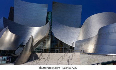 Los Angeles, California USA - July 14, 2018: Walt Disney Concert Hall main entrance and steps shows curving steel exterior designed by Frank Gehry, from the corner of First and Grand in downtown.