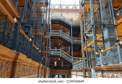 Los Angeles, California USA - July 14, 2018: Historic Bradbury Building interior atrium in downtown from 1883 with wrought iron balconies, railings and stairways, skylight above, antique elevators