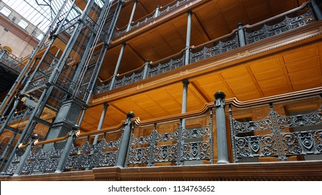 Los Angeles, California USA - July 14, 2018: Ornate balcony railings and wrought iron elevator cage in the historic Bradbury Building interior in downtown, built in 1883