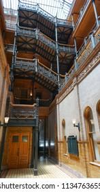 Los Angeles, California USA - July 14, 2018: Landmark Bradbury Building interior atrium,1883 with wrought iron balconies, railings and stairways, skylight above, used in the film Blade Runner