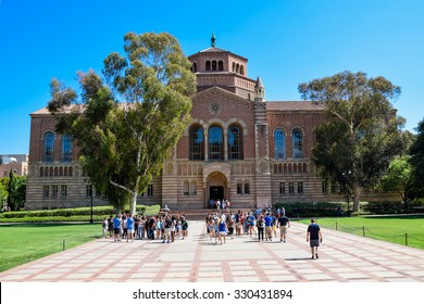 Los Angeles, California, USA - July 9. 2015: A group of people (students and families) get a guided tour of the University of California Los Angeles (UCLA) campus. Powell Library is in the background.