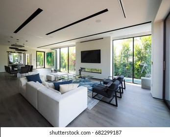 Los Angeles, California USA. July 17, 2017. New construction modern home interior with model furniture and interior design setting before going into the real estate market