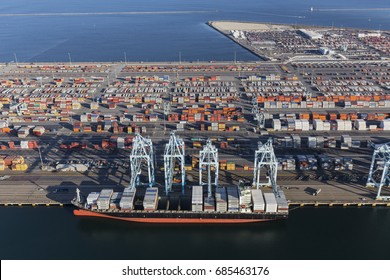 Los Angeles, California, USA - July 10, 2017:  Aerial view of Terminal Island cargo containers and ship in Southern California.