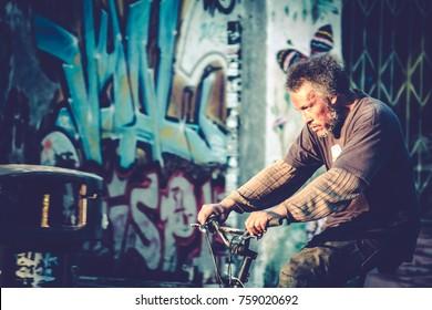 Los Angeles, California / USA - July 7 2017: Homeless Man Bikes Through Highland Park, Los Angeles