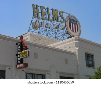 Los Angeles, California USA - June 7, 2018: Helms Bakery streamline moderne building, 1931 Art Deco, in Culver City with the sign indicating the company provided bread to the 1932 Olympics