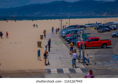 Los Angeles, California, USA, JUNE, 15, 2018: Above view of unidentified people in Santa Monica beach enjoying the summer day and walking path for biking and rolling skating in Los Angeles