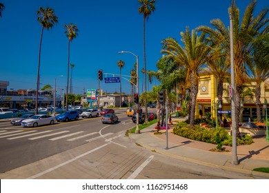 Los Angeles, California, USA, JUNE, 15, 2018: View of cars parked at one side of the road in the streets in Santa monica. The city is named after the Christian saint Monica
