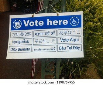 Los Angeles, California USA - June 5, 2018: Polling place sign for an election in the United States says Vote Here in multiple languages in a variety of alphabets