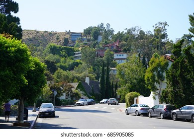 Los Angeles, California, USA - JUNE 23, 2017: Hollywood Hills street view and expensive houses and cars