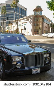 LOS ANGELES, CALIFORNIA, USA - MARCH 2009: Rolls Royce limousine owned by the Beverly Wilshire hotel parked outside the hotel. The car has a licence plate personalised to the hotel