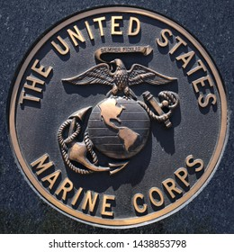 Los Angeles, California / USA - March 12 2019: U.S. Marine emblem, crest or plaquet on black granite background