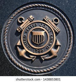 Los Angeles, California / USA - March 12 2019: U.S. Coast Guard emblem, crest or plaque on black granite background