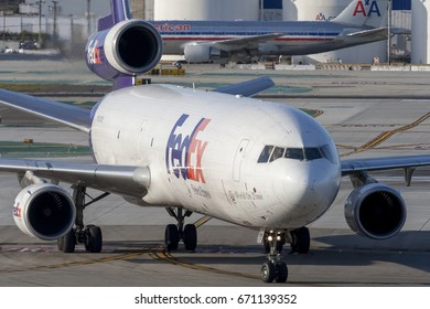 Los Angeles, California, USA - March 10, 2010: Federal Express (FedEx) McDonnell Douglas MD-11F cargo aircraft at Los Angeles International Airport.