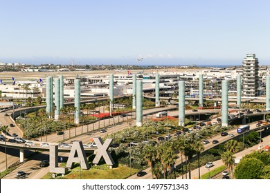 LOS ANGELES, CALIFORNIA, USA - MAY 22, 2019: The Los Angeles International Airport with its streets, entrances and exits. In the foreground is the LAX-sign. Captured from above.