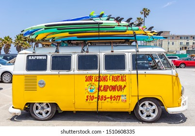 Los Angeles California USA. May 30, 2019. Venice beach, Surf boards stacked on a yellow van roof, surf school adv, sunny spring day