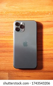 Los Angeles, California / USA - May 5, 2020: Apple iPhone 11 Pro on a wooden desk
