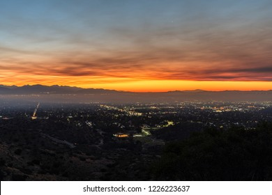 Los Angeles, California, USA - November 10, 2018:  Smoke filled dawn sky above the San Fernando Valley.  Smoke is from the Woolsey fire in Malibu and Ventura County.