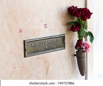 Los Angeles, California, USA, November 5, 2017: Marilyn Monroe's grave at the Westwood Memorial Park is visited daily by tourists who leave lipstick-smeared kisses
