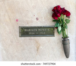 Los Angeles, California, USA, November 5, 2017: Marilyn Monroe's Crypt with flowers at Westwood Memorial Park. Her grave is visited daily by tourists who leave lipstick-smeared kisses