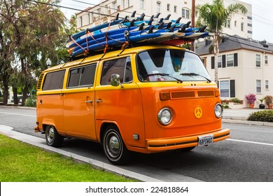 LOS ANGELES, CALIFORNIA, USA - OCT 21: Volkswagen transporter with surf boards parked on the street, Los Angeles, CA, USA on oct 21, 2013. Famous van was manufactured for about 64 years in 1949-2013.