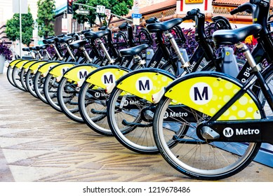 Los Angeles, California / USA - October 14 2018: Metro Bikes ready for rental at a  station in downtown Los Angeles. The Metro Bike Share system features hundreds of  bikes available 24/7 all over LA.