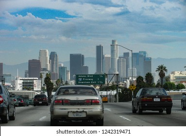Los Angeles, California USA - October 1, 2010: The skyline of downtown Los Angeles, California seen from the freeway, with the San Gabriel Mountains range in the background