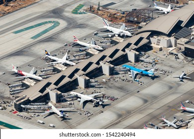 Los Angeles, California / USA - September 13 2018. Aerial overview of Tom Bradley International Terminal (TBIT) at LAX Airport. Multiple wide body aircraft of Airbus and Boeing visible.