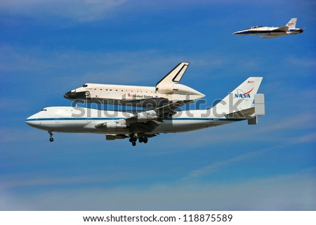 LOS ANGELES, CALIFORNIA, USA - SEPTEMBER 21: Space Shuttle Endeavour makes dramatic final flight around Los Angeles Downtown on September 21, 2012 in Los Angeles, California