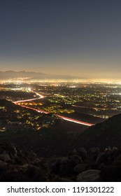 Los Angeles California vertical predawn view of Porter Ranch and the 118 freeway in the San Fernando Valley.  Burbank, North Hollywood and the San Gabriel Mountains are in background.