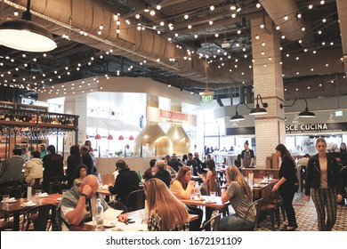 Los Angeles, California/United States - 02/23/2020: A view of several guests enjoying an array of Italian restaurant vendors inside Eataly.