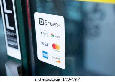 Los Angeles, California/United States - 07/01/2020: A view of a restaurant window decal advertising the available payment service of Square, Apple Pay, Google Pay, Visa, MasterCard, American Express.