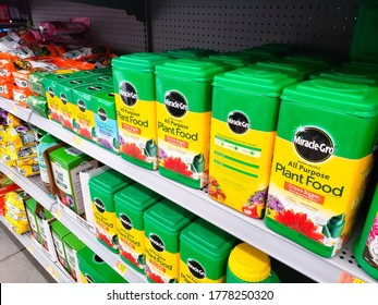 Los Angeles, California/United States - 07/01/2020: A view of several containers of Miracle-Gro all purpose plant food, on display at a local grocery store.