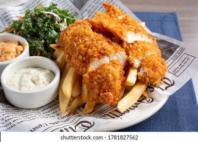 Los Angeles, California/United States - 07/22/2020: A view of a plate of breaded deep fried chicken tenders, in a restaurant or kitchen setting.