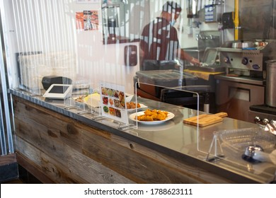Los Angeles, California/United States - 07/22/2020: A view of a local restaurant counter, featuring a health code plastic screen