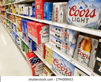 Los Angeles, California/United States - 07/22/2020: A view of a variety of popular brand cases of beer cans and bottles, on display at a local grocery store.