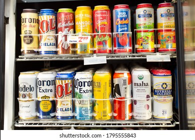 Los Angeles, California/United States - 07/22/2020: A view of a commercial beverage refrigerator featuring several popular brands of tall can beer, on display at a local liquor store.