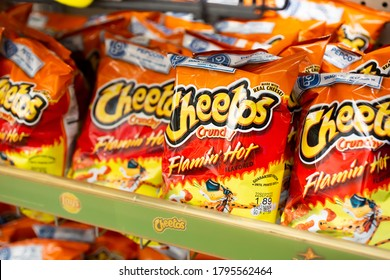 Los Angeles, California/United States - 07/22/2020: A view of several bags of Cheetos Crunchy Flamin' Hot chips, on display at a local grocery store.
