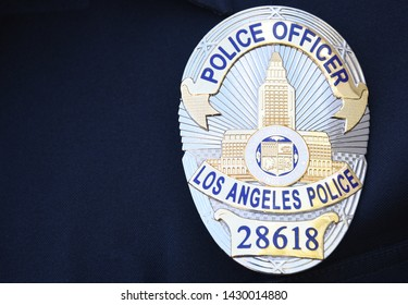 Los Angeles, California/United States - October 14, 2018: Close up of a Los Angeles Police officer badge attached to blue uniform shirt.