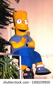 Los Angeles, California/US - circa 1990s: Bart Simpson holds an Emmy Award.