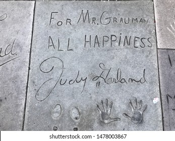 Los Angeles, California/USA. Actress Judy Garland's handprints and signature In the cement at the Chinese Theater in Hollywood.