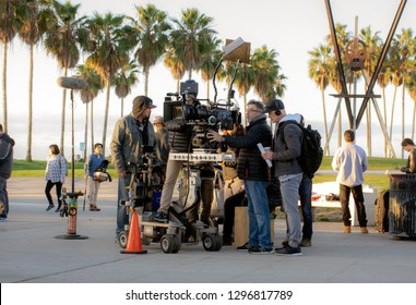 Los Angeles, California/USA - January 10, 2019: Hollywood camera crew films scene for television show NCIS Los Angeles on the Venice Beach boardwalk.