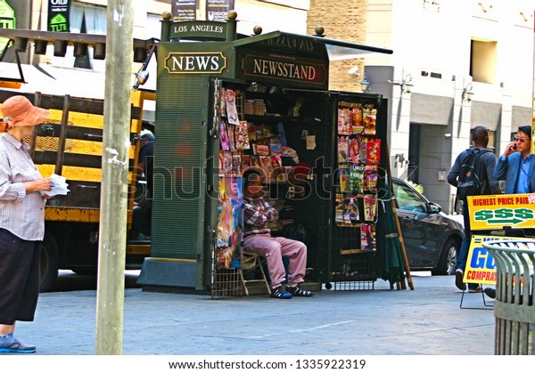 Los Angeles, Calif./USA-May 6, 2014: A man tends to a news kiosk on a street corner downtown.