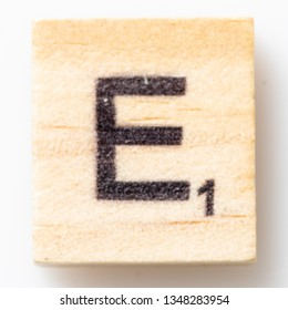 Los Angeles, CA/USA 02/24/2019 Wooden Scrabble letter E on white background from above