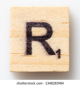 Los Angeles, CA/USA 02/24/2019 Wooden Scrabble letter R on white background from above
