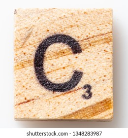 Los Angeles, CA/USA 02/24/2019 Wooden Scrabble letter C on white background from above