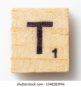 Los Angeles, CA/USA 02/24/2019 Wooden Scrabble letter T on white background from above